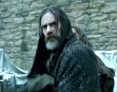 A final glance from Murtagh as he and Jamie are  separated. Ardsmuir prison is closing and the prisoners are being relocated to the colonies to serve as indentured servants for 14 years. All except Jamie.