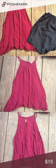 Charlotte Russe High-Neck Tank NWOT Beautiful  burgundy color. High-Neck Tank with poms on the bottom. A transitional piece. Great for summer with shorts, in the fall pair it with skinny jeans and a plaid flannel. NWOT. ️Size:M Fastens in back. 100% Rayon. Last Picture is to show fit. ❌Trades ❌Holds ✅Reasonable Offers Accepted. Offer Button Only. Charlotte Russe Tops Tank Tops