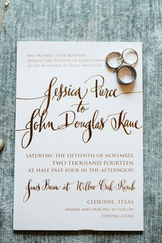Gold foil invitations, with a mix of whimsical and formal type, set the tone for Jessica and John's rustic meets luxe wedding at Willow Creek Ranch in Cleburne, Texas.