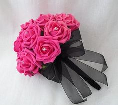 Hot Pink And Black Bouquets - Bing Images would love this with purple roses and turquoise ribbon