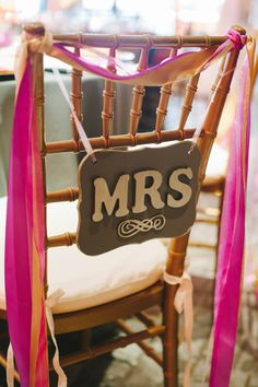 chair sign + ribbons, photo by Dixie Pixel Photography http://ruffledblog.com/virginia-boathouse-wedding #weddingideas #chairbacks