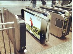 Really clever iPhone graphic wrapped on a turnstile.