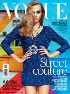 Cover girl: On the front cover, the model of the moment took on a sexy pose in a midnight blue glitter mini-dress and a statement pendant, bearing the word 'Hot'