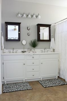 basic builder's grade bathroom makeover on a budget, add wood feet to a bathroom vanity, repair swollen mdf cabinet doors and add knobs