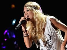 CMT News: 2013 CMA Music Festival: Carrie Underwood, Brad Paisley Shine Through Storm Clouds