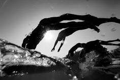 Image has been converted to black and white.) The Athletes dive ionto the water at the start of the Men's Individual Triathlon at the Triathlon Venue during day two of the Asian Games Guangzhou 2010 on November 2010 in Guangzhou, China. Open Water Swimming, Keep Swimming, Sport Motivation, Ironman Triathlon, Asian Games, Sport Fitness, Sports Pictures, How To Stay Motivated, Diving