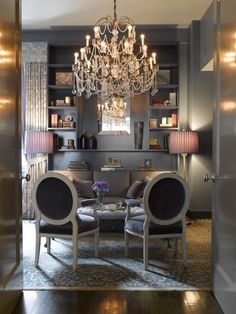 Chandelier.  Wouldn't an over-the-top, but untraditional chandelier like this one look great with the wood and linen in the dining room . . . .hmn.