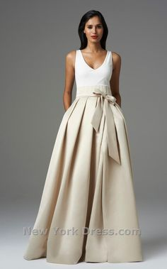 Get glamorous in this delightful evening dress from Aiden Mattox. The v-neckline bodice has bra-friendly straps and a thick waistband, cinched with a