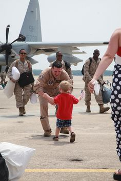 MARINE CORPS AIR STATION CHERRY POINT, N.C. (July 4, 2012) -- Capt. Samuel Robinson, the detachment legal officer with Marine Aerial Refueler Transport Squadron 252, embraces his son James at an Independence Day homecoming celebration, July 4, after three months supporting the 24th Marine Expeditionary Unit. Robinson made it home just in time for his son's and wife's birthdays, which are both on the 4th of July. Capt. Samuel Robinson, the detachment legal officer with Marine Aerial Refueler…