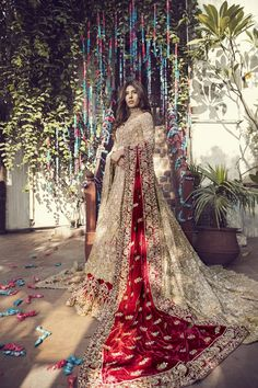 Top Pakistani Bridal Designers And Their Festive Wear Cost Gold bridal lehenga with maroon dupatta. Asian Bridal Dresses, Asian Wedding Dress, Indian Bridal Outfits, Indian Bridal Lehenga, Pakistani Wedding Outfits, Pakistani Bridal Dresses, Pakistani Wedding Dresses, Bridal Dress Indian, Indian Wedding Sarees