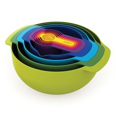 This colorful set of space-saving kitchenware contains mixing bowls, measuring cups, sieve and strainer that all stack together. By Joseph & Joseph.