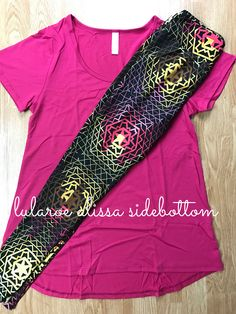 Bright magenta/pink classic t paired with multi colored lularoe leggings with a black background to make them pop!