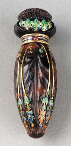 A TORTOISE-SHELL AND ENAMELED 18 KARAT GOLD PERFUME FLASK** Tiffany & Co., circa 1905 with original fabric box 3in. (7.6cm.) long the flask stamped TIFFANY & CO. with French 18K gold poinçons, the inside of the box marked TIFFANY & CO. 36 bis AVENUE DE L'OPERA PARIS