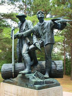 Lumberman's Monument   Erected in 1931 as a lasting memorial to the lumbermen that harvestd Michigan's giant white pine.  The 14 foot bronze statue overlooks the Au Sable River.  The three men represent various stages of the historic lumbering operation.    Inscription:  Erected to perpetuate the memory of the pioneer lumbermen of Michigan through whose labors was made possible the development of the prairie states.   Oscoda, Michigan..such a beautiful place with the woods and the lake