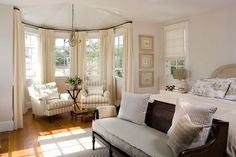 love the chairs in the bay window