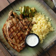 Greek Pork Chops with Lemon Rice Pilaf - wonder if I could add carrots & peas instead of zucchini?
