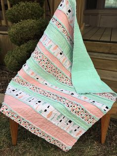Southwest Baby or throw size Rag Quilt, In a feather and arrows print with soft shades of mint and peach.Handmade quilt! In a strip design