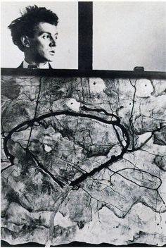 Austrian painter Egon Schiele (1890-1918) behind his painting 'Autumn Tree in Stirred Air (Winter Tree)' (1912). Photograph: Atelier Ungar, Neulengbach. via Egon Schiele Autograph Database