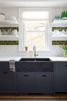 This Colonial-style countryside retreat was designed as a turn-key property by Chango & Co., located in the historic town of Litchfield, Connecticut. White Kitchen Backsplash, Black Kitchen Cabinets, Kitchen Tiles, Kitchen Decor, Backsplash Ideas, Kitchen Sink, White Cabinets, Kitchen Furniture, Soapstone Kitchen