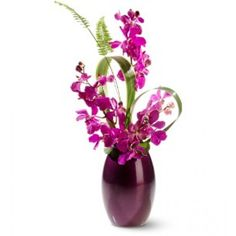 or an unexpected gift, send fresh flowers with a touch of the exotic… deep purple dendrobium orchids, arching gracefully from a matching Ming vase.
