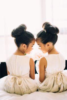 The cutest matching flower girls - love those big ballerina buns!   Natasja Kremers Photography