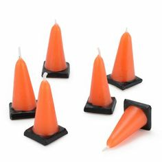 these are the most adorable construction cone candles seen atop the cake in our sample images of the construction birthday party