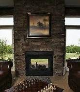 Two story stone outdoor fireplace fireplaces and for Back to back indoor outdoor fireplace