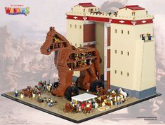 While the existence of Troy and and battle between them and the Greeks has been recorded in history the exact nature of the Trojan Horse itself isn't, so designer and builder Mitchell Kruik had some license to create his as big as he needed to. In true Brickman style the horse, modeled of course on the classic LEGO horse mold, is a cutaway so you can see all the soldiers hiding inside! The horse and surrounding walls of Troy took 53 hours and 9,500 bricks to build.