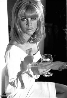 Julie Christie with a glass of wine, 1964.