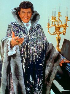 Liberace. The one who invented bling. My dad told me that when I wear all my rings I look like Liberace HAHAHAHA I take that as a compliment!
