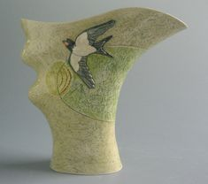 """'Jug with swallow and lark."""" Handbuilt earthenware pottery by Anna Lambert. """"From simple bowls to complex multiple forms, I aim to present memories of land and seascape and of my enjoyment of the ordinary."""" (Information, Anna Lambert's website)"""