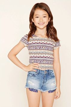 Forever 21 Girls - A pair of distressed denim cutoff shorts featuring a five-pocket construction, a zip fly, buttoned waist, and floral lining.