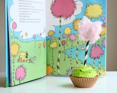Dr. Seuss- The Lorax cupcakes (with cotton candy on top!) Love these sticks.straws better!