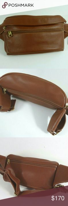 """Rare Coach Vintage Leather Waist Pouch Fanny Pack Authentic COACH Vintage Leather Waist Pouch Fanny Pack M/L featured in British Tan.   This is a unisex 1991 piece made in the United States.   Near Mint condition!  Never worn, just minor scuff from storage ~ British Tan glove-tanned cowhide  ~ Brass hardware  ~ Front gusseted zipper pocket  ~ Hidden zipper compartment under flap  ~ Full length zipper back pocket  ~ 2 side snap pockets  ~ Adj waist strap with brass buckle M/L ~ 8 1/2"""" L (left…"""