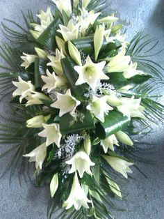 double ended casket spray- classic Lily design. Casket Flowers, Grave Flowers, Cemetery Flowers, Funeral Floral Arrangements, Church Flower Arrangements, Funeral Bouquet, Funeral Flowers, Funeral Caskets, Funeral Sprays