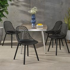 Outdoor dining has never been more appealing with the help of our outstanding chairs. Featuring weather-resistant properties and a unique plastic blend material, our outstanding outdoor dining chair set provides astonishingly stable frames that will last you for years to come. This minimalistic design balances clean-cut lines and a diamond mesh pattern to create an impressive look of sturdy structure and stylish comfort. Finished with a modern vibe, our chair set is sure to transform any… Outdoor Dining Chairs, Modern Dining Chairs, Patio Chairs, Dining Chair Set, Outdoor Furniture Sets, Craftsman House Numbers, Wood Adirondack Chairs, The Help, Christopher Knight