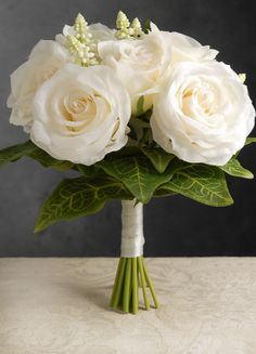 "Huge Deluxe Cream Roses and Mucari flowers are poly silk this is a gorgeous Bridal Bouquet!     Measures  11"" x 11"" x 9""  Rose heads are 2.5 to 3.75"" wide  leaves are 4"" x 3.5""  Stems are wrapped with ribbon.    This Bouquet is ready for your wedding day!"