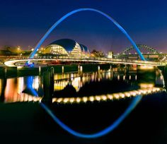 The Gateshead Millennium Bridge is a pedestrian and cyclist tilt bridge spanning the River Tyne in England between Gateshead's . quarter on the south bank, and the Quayside of Newcastle upon Tyne on the north bank. History Of Bridges, Famous Bridges, Beautiful London, The Beautiful Country, Beautiful Sky, Gateshead Millennium Bridge, Rialto Bridge, Beautiful Architecture, Sydney Harbour Bridge