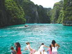 Admiring the limestone cliffs and crystal clear water while cruising around by boat at Koh Phi Phi Ley.