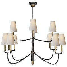 The Farlane 2-Tier Chandelier by Visual Comfort uses a layered and detailed downrod to put ample arms and unique design on display. The upper arms each support single candleholder lamps, while the lower arms each support a double candelabra. Tall, tapered, Natural paper shades adorn each of these candleholders and expertly diffuse significant light output to the room. Sloped ceiling mount included. Dimmable with a standard incandescent dimmer (not included).