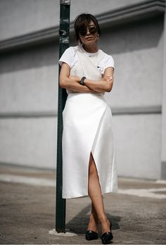 Transition your summer dresses into fall with these stylish outfit ideas for layering T-shirts | 'Z Hours' blogger in white formal dress, casual white tee, black pumps