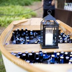 I saw this at a wedding a few years ago and it was awesome!Canoe Ice chest!
