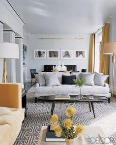 grey wall - dark hardwood - white trim - yellow accent