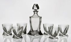 "Classic, sleek Liquor set with a elegant twist design. Imported European Crystal, this set includes a large decanter and six (6) ""rocks"" glasses. Set includes decanter & 6 glasses Crystal Decanter has crystal stopper (Not plastic) Decanter holds 850 ml (about 28.75 ounces) Each glass holds 340 ml (about 11.5 ounces) Lead Free Crystal"