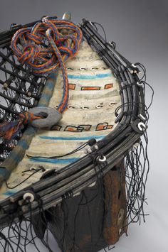 High Dock Detail: Coastal debris with woven and stitched boat frame, paper,encaustic Artist: Shannon Weber, Oregon.