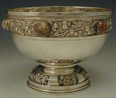 Edith Linnell. Edith Linnell. An Arts and Crafts silver bowl, hard pink stone insets, with  fruiting branch decoration. 1920. Stamped E.L. and SILVER to applied plaque. 18.5 cm wide, 13.5 cm high. Sold by Titus Omega. View 1.