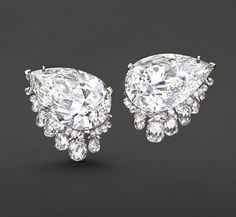 Striking pear and briolette diamond earrings by Fred Leighton, ~49 carats