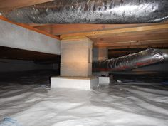 #Crawlspace Block #Piers added to a beam between the floor joists that is preventing the sub floor from sagging.  An interior wall was constructed between the joists.  http://www.indianacrawlspacerepair.com/crawl-space-structural-floor-repairs/