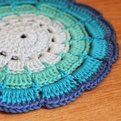 Technically a coaster (link doesn't take to pattern or even actual picture, FYI), but I would love to do this as a rug