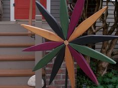 For your outdoor and indoor decorating this year consider my colorful wooden folk art style starburst wreath made from reclaimed pine wood.  The warm tones and friendly design will be a subtle and refreshing rustic decoration to enjoy throughout the year. Makes wonderfully colorful gift that will last for years! Add color to an outdoor wall or brighten up your garden area. Many people like to place their starburst art indoors as well to bring colors a wall area. Starbursts are stained and…